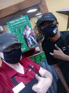 The Round Rock store came in hot and won the first week! Congratulations, and a big thumbs up from some Smokey Mo's team members in front an MDA charity poster.