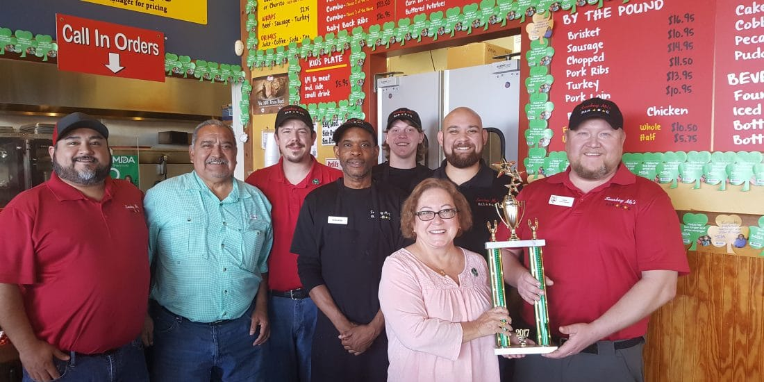 Smokey Mo's employees and our MDA trophy at our Cypress Creek Smokey Mo's store.