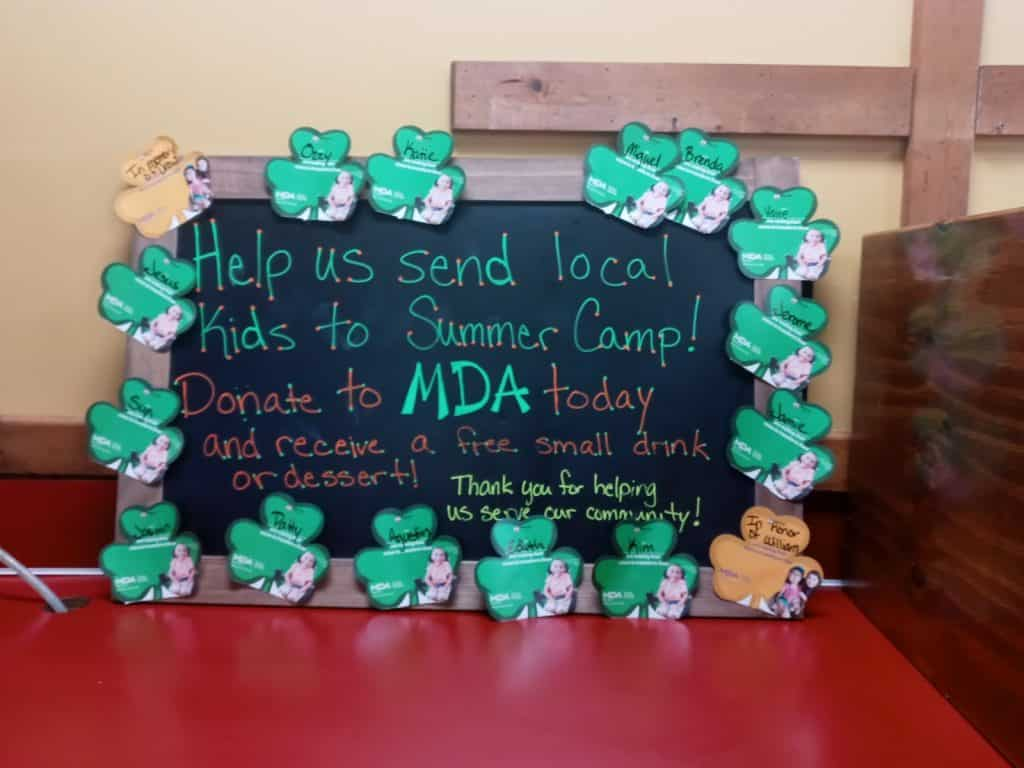 Smokey Mo's supporting MDA Charity at our Round Rock Smokey Mo's store. Several of those shamrocks were purchased by our team members!